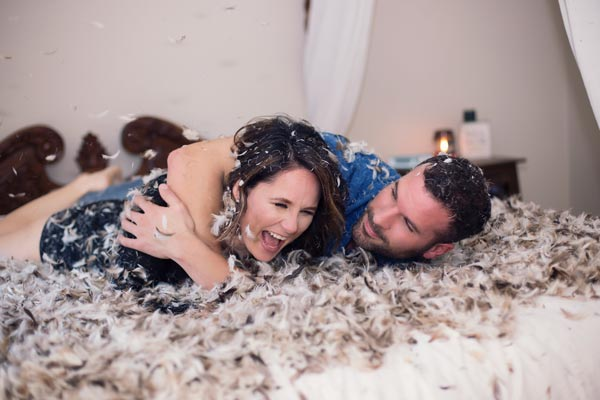 Couple Wrestling in Feathers