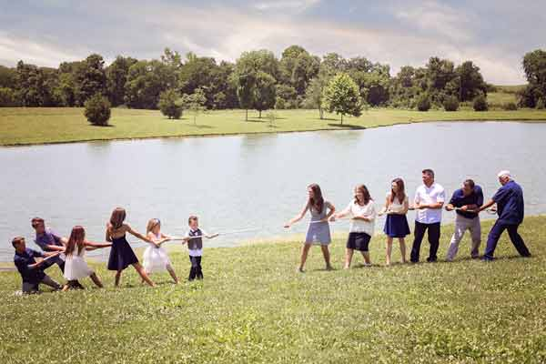Family of 12 playing tug-of-war