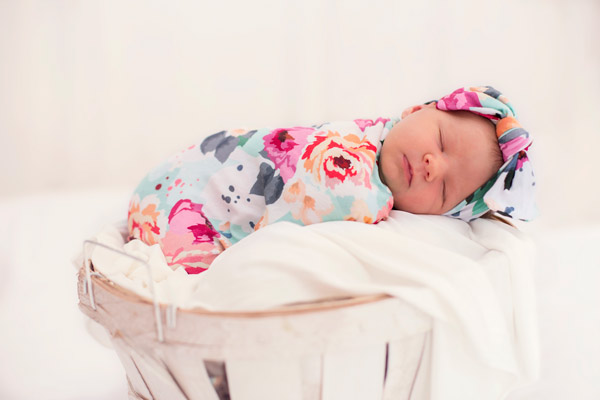 Newborn Baby Girl in Floral Basket