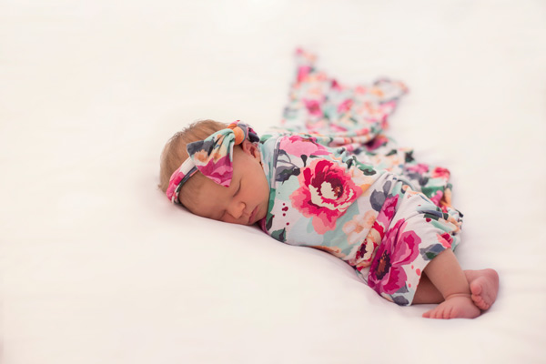 Newborn Baby Girl in Floral Wrap