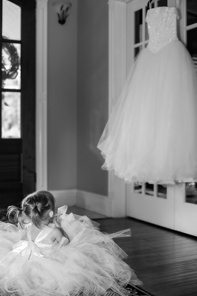 Flower Girl Admiring Her Mommy's Dress